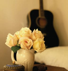 White roses beside bed