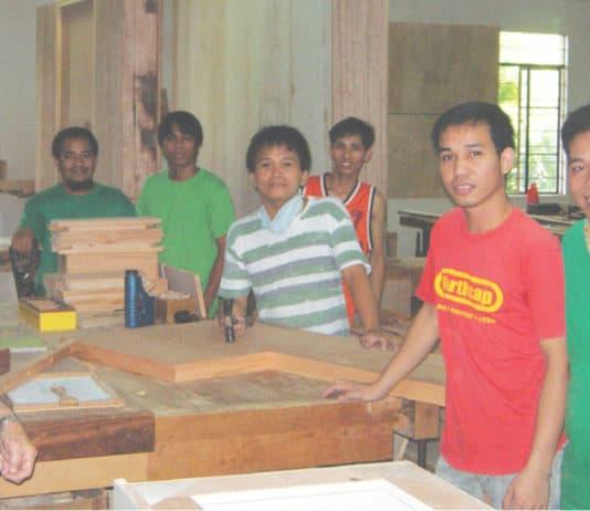 Carlo Degasperi Cause with several carpenters