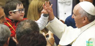 Pope Francis with an autistic child