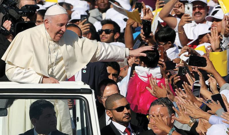 ens of thousands of Catholics and several thousand Muslims attended the first papal Mass in the Arabian peninsula.